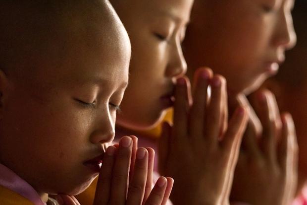 Burmese nuns meditating